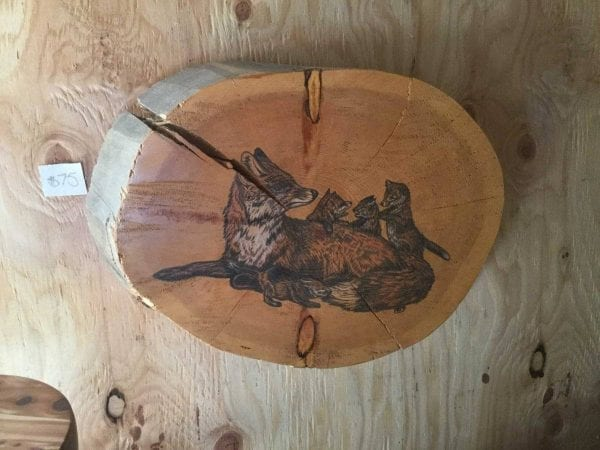 hand painted foxes on log